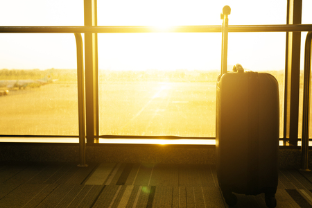 close up of suitcase or luggage with sunlight  in airport, travel concept Foto de archivo
