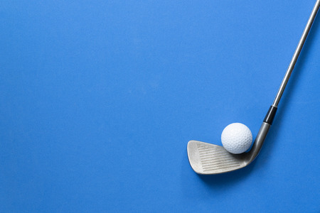golf ball and golf club on blue background Stock Photo