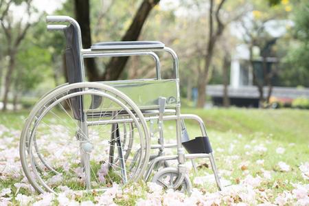 Empty wheelchair in the park