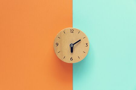 Retro alarm clock on color table, vintage style on the good morning concept