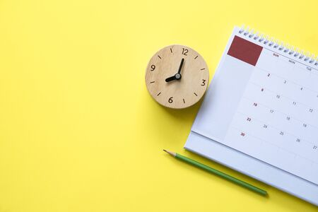 close up of calendar on the yellow table, planning for business meeting or travel planning concept
