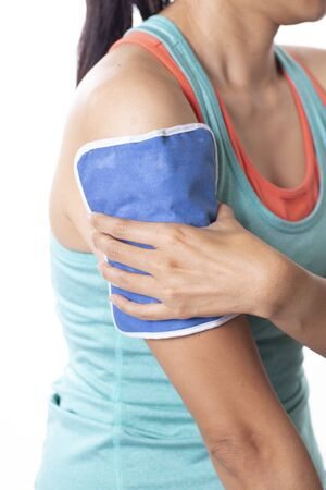 woman putting an ice pack on her arm pain, isolated white background