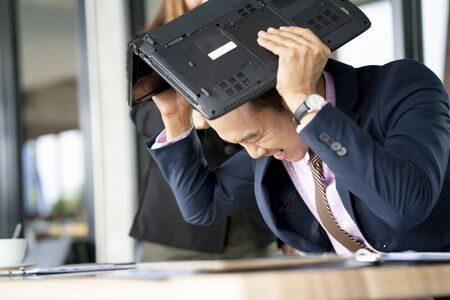 Strained businessman looks grave and so stressful with his working plan for market share or the company profits, failure and stress concept Stock fotó