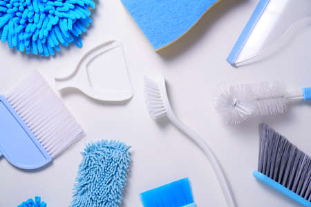 House cleaning blue product on white table background, housekeeping concept