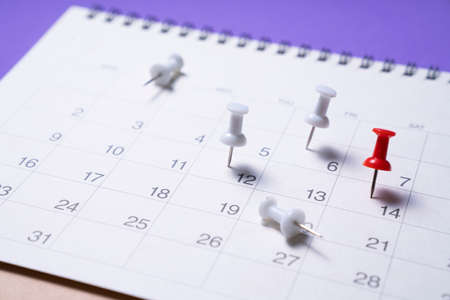 close up of calendar on the purple table, planning for business meeting or travel planning concept 版權商用圖片