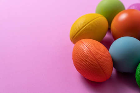 close up stress balls on pink background, stress or sport exercise equipment concpet