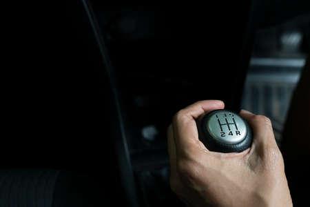 close up hand with manual gear shift lever, car transportation concept Archivio Fotografico