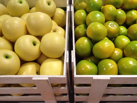 faked: Green apples and Chinese oranges in basket