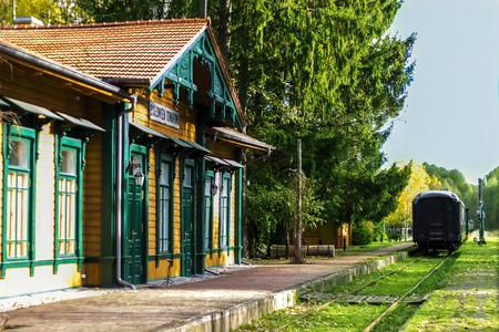 Old beautifull vintage railway station with train in Poland,Bialowieza, in autumn Stock Photo
