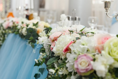 Flower wedding decoration with candles and angel