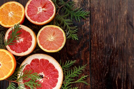 ripe fresh sliced grapefruit and orange on wooden background