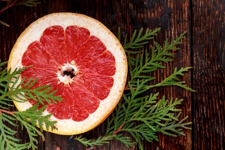 A Slice of Grapefruit on a wooden Background