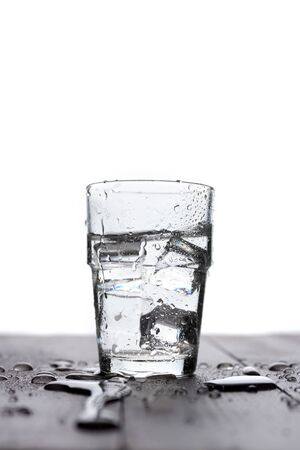 Glass of clear water on a white background