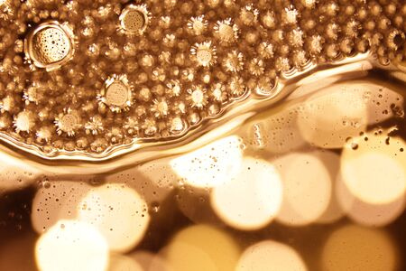 Bubbles in water on gold background horizontal pattern. Circle and liquid, light design