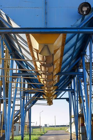 Processing complex intended for coarse purification, drying up, and temporary storage of grain. Detail of transportation grain seeds.