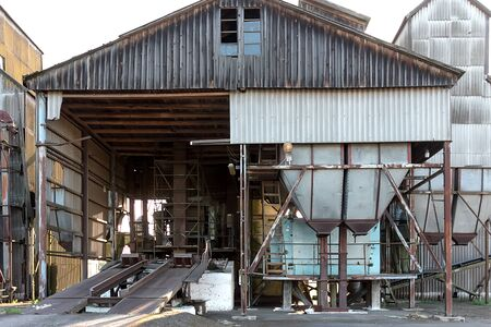 Details of old abandoned grain drying complex. Old building for storing and pouring grain.
