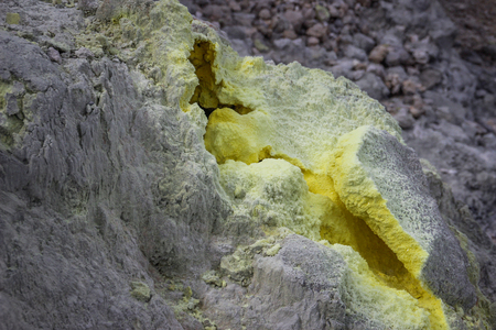 Bright yellow gaps in the rock of a volcano where hydrogen sulfide gas comes out Stok Fotoğraf