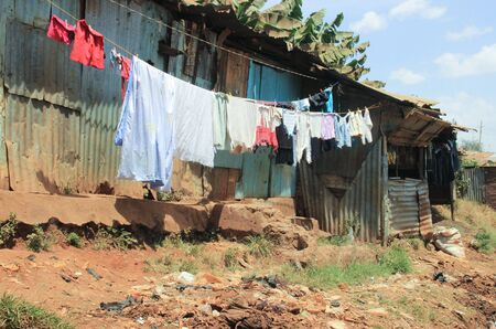 clothes are drying on ropes in the slums of Nairobi - one of the poorest places in Africa Imagens