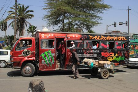 Nairobi, Kenya - January 17, 2015: Unusual painted red city bus in Nairobi.