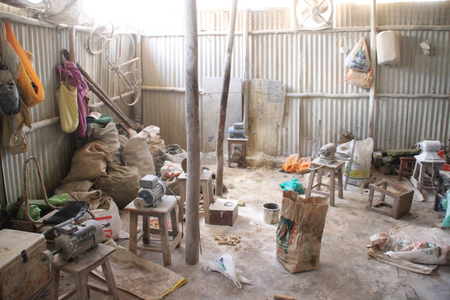 Kibera, Nairobi, Kenya - February 13, 2015: The working room of the factory for the production of souvenirs from bones