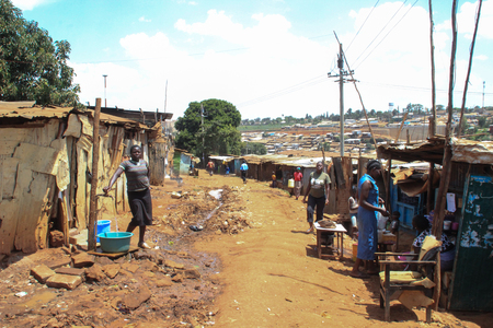 Kibera, Nairobi, Kenya - February 13, 2015: a street in slums with poor huts