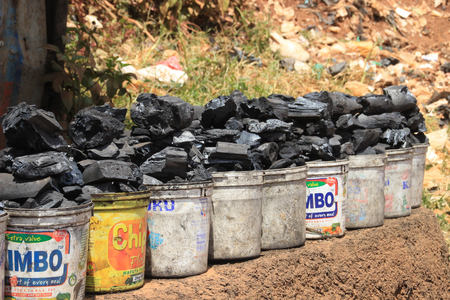 Kibera, Nairobi, Kenya - February 13, 2015: plastic buckets of coal are sold on the street of the poorest region of Africa