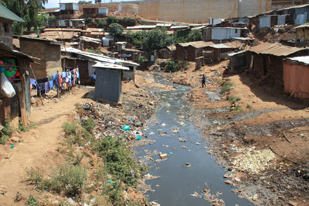 Kibera, Nairobi, Kenya - February 13, 2015: Huge heaps of garbage and a dirty river in the slums of Nairobi - one of the poorest places in Africa Editorial