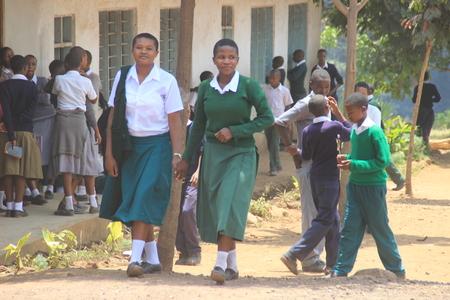Arusha, Tanzania - March 13, 2015: Tanzanian public high school students in school uniform are smiling