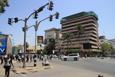Nairobi, Kenya - January 17, 2015: road in the city center with pedestrians, cars and traffic lights Editorial