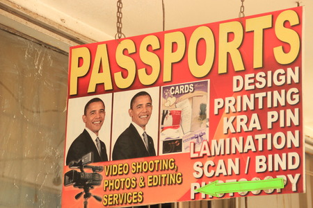 Nairobi, Kenya - January 17, 2015: an advertising sign with a portrait of US President Barack Obama for a passport in Nairobi Editorial