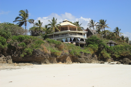 Diani Beach, Kenya - February 20, 2015: Hotel on the shores of the Indian Ocean surrounded by palm trees. Kenya, Africa Editorial