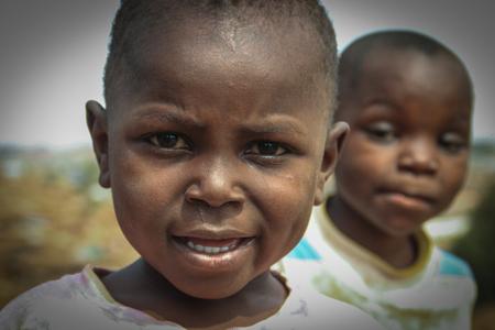 Kibera, Nairobi, Kenya - February 13, 2015: two poor black boys in the Kiber slums