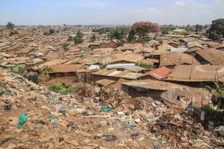 Kibera, Nairobi, Kenya - February 13, 2015: Huge heaps of garbage in the slums of Nairobi - one of the poorest places in Africa Editorial