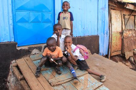 Kibera, Nairobi, Kenya - February 13, 2015: A group of poor children at a burnout hut in slums