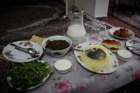 Traditional Iranian homemade food: beans, rice, greens and sour milk Banco de Imagens