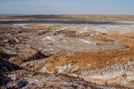 Salt Lake Namak in the province of Qom, Iran (Persia) - salt crystals on brown earth
