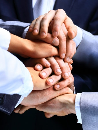 Closeup Of A Business Colleagues With Their Hands Stacked photo