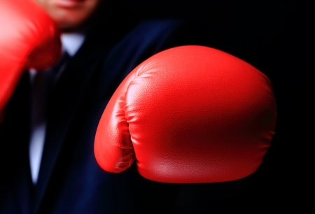 businessman in boxing gloves isolated on black Stock Photo - 23693966