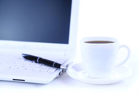 netbook: white netbook with black coffee top view  Stock Photo