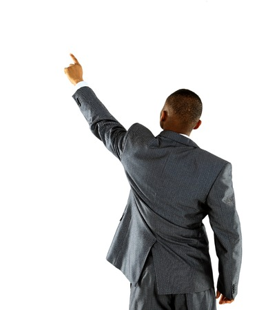 African businessman pointing at wall. rear view. Isolated over white . photo