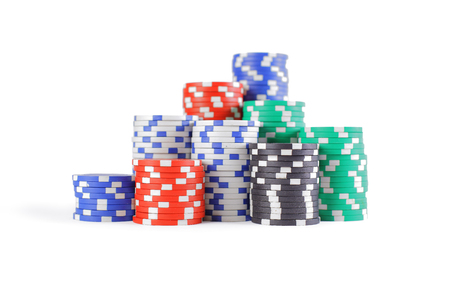 red black white: Stacks of poker chips including red, black, white, green and blue on a white backgroun
