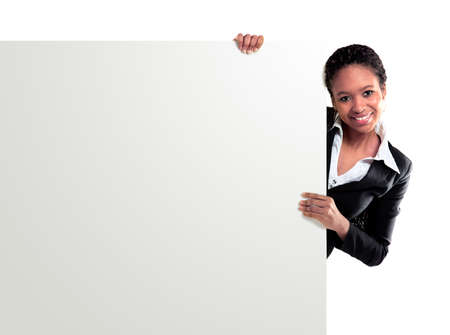 Female representative pointing towards placard and smiling at camera  photo