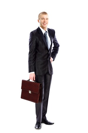 centrality: Full length portrait of young business man holding briefcase in hand isolated on white  Stock Photo