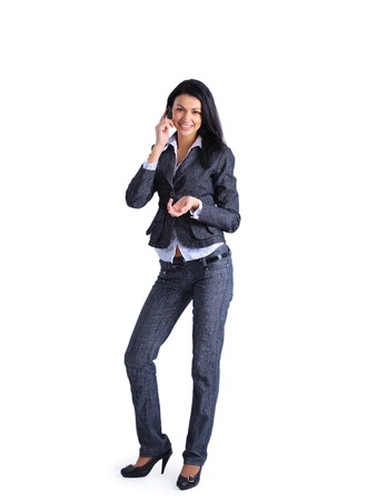 telco: Portrait of young businesswoman talking on mobile phone isolated on white background