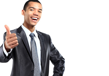 Portrait of a smiling African American business man gesturing a thumbs up sign on white background  photo
