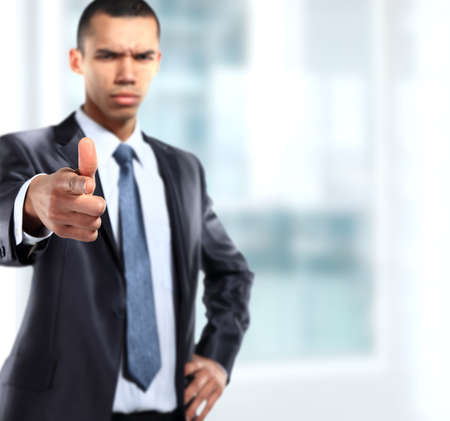 Serios business man showing finger to be number one photo