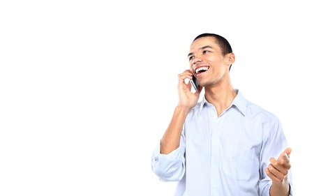 cell phone: young smiling black businessman talking on cell phone isolated on white Stock Photo