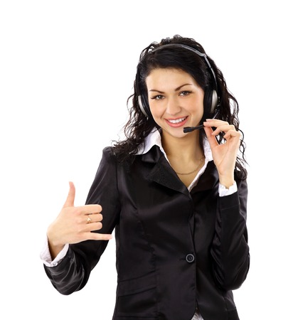 Beautiful business woman with headset and showing ok sing.  photo