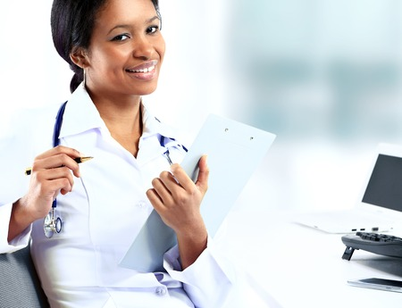 beautiful african american female pediatric nurse in modern office photo