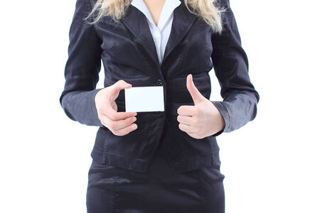 Businesswoman showing and handing a blank business card.  photo